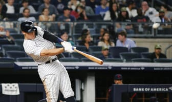 Sep 17, 2021; Bronx, New York, USA; New York Yankees right fielder Aaron Judge (99) hits a solo home run against the Cleveland Indians during the fourth inning at Yankee Stadium. Mandatory Credit: Andy Marlin-USA TODAY Sports