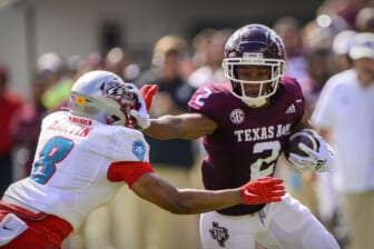 Sep 18, 2021; College Station, Texas, USA; Texas A&M Aggies wide receiver Chase Lane (2) stiff arms New Mexico Lobos cornerback Donte Martin (8) during the first half at Kyle Field. Mandatory Credit: Jerome Miron-USA TODAY Sports