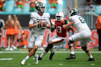 Sep 18, 2021; Miami Gardens, Florida, USA; Michigan State Spartans quarterback Payton Thorne (10) drops back before attempting a pass during the first half against the Miami Hurricanes at Hard Rock Stadium. Mandatory Credit: Jasen Vinlove-USA TODAY Sports