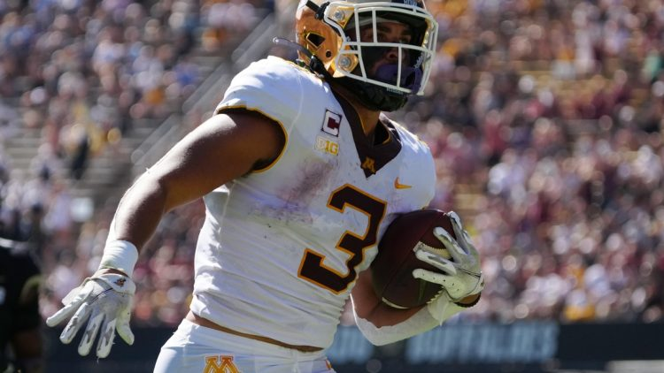 Sep 18, 2021; Boulder, Colorado, USA; Minnesota Golden Gophers running back Treyson Potts (3) carries for a touchdown in the first quarter at Folsom Field. Mandatory Credit: Ron Chenoy-USA TODAY Sports