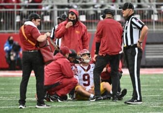 Sep 18, 2021; Pullman, Washington, USA; USC Trojans quarterback Kedon Slovis (9) is checked out by medical staff during a game against the Washington State Cougars in the first half at Gesa Field at Martin Stadium. Mandatory Credit: James Snook-USA TODAY Sports