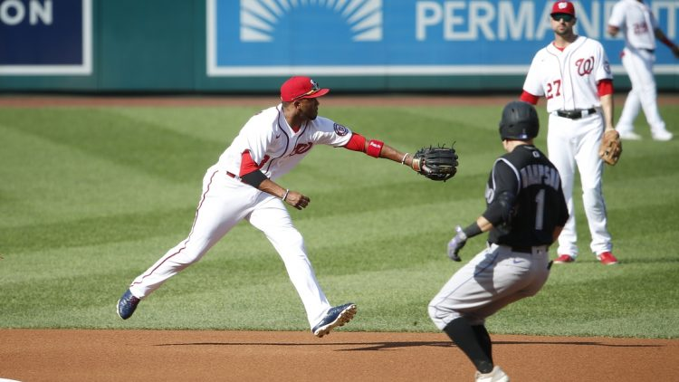 Sep 18, 2021; Washington, District of Columbia, USA; Washington Nationals shortstop Alcides Escobar (3) reaches for the ball as Colorado Rockies center baseman Garrett Hampson (1) runs to second base in the second inning at Nationals Park. Mandatory Credit: Amber Searls-USA TODAY Sports