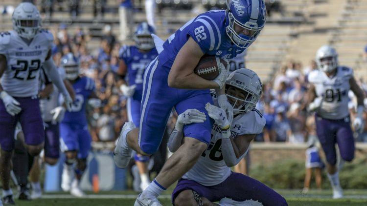 Sep 18, 2021; Durham, North Carolina, USA; Duke Blue Devils tight end Cole Finney (82) is tackled by Northwestern Wildcats safety Brandon Joseph (16) during the second quarter at Wallace Wade Stadium. Mandatory Credit: William Howard-USA TODAY Sports