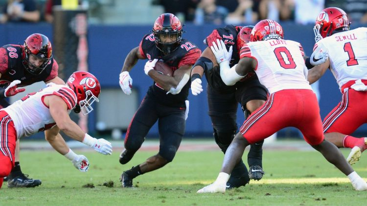 Sep 18, 2021; Carson, California, USA; San Diego State Aztecs running back Greg Bell (22) runs the ball against the Utah Utes during the first half at Dignity Health Sports Park. Mandatory Credit: Gary A. Vasquez-USA TODAY Sports
