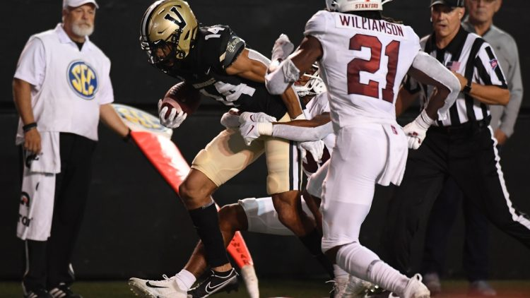Sep 18, 2021; Nashville, Tennessee, USA; Vanderbilt Commodores wide receiver Will Sheppard (14) runs for a first down after a reception during the first half against the Stanford Cardinal at Vanderbilt Stadium. Mandatory Credit: Christopher Hanewinckel-USA TODAY Sports