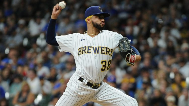 Sep 18, 2021; Milwaukee, Wisconsin, USA;  Milwaukee Brewers relief pitcher Devin Williams (38) delivers a pitch against the Chicago Cubs in the eighth inning at American Family Field. Mandatory Credit: Michael McLoone-USA TODAY Sports