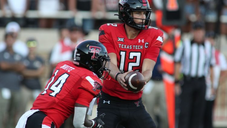 Sep 18, 2021; Lubbock, Texas, USA; Texas Tech Red Raiders quarter back Tyler Shough (12) hands off to running back Xavier White (14) against the Florida International Panthers during the first half at Jones AT&T Stadium. Mandatory Credit: Michael C. Johnson-USA TODAY Sports
