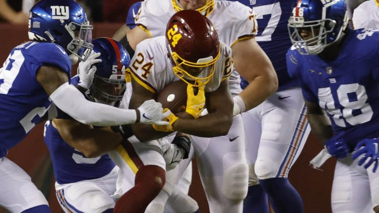 Sep 16, 2021; Landover, Maryland, USA; Washington Football Team running back Antonio Gibson (24) carries the ball against the New York Giants at FedExField. Mandatory Credit: Geoff Burke-USA TODAY Sports