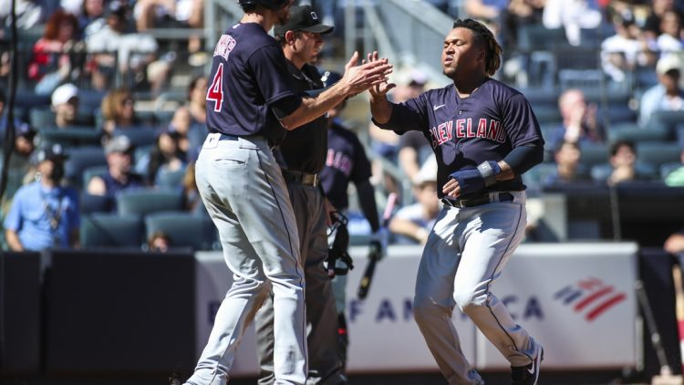 Sep 19, 2021; Bronx, New York, USA;  Cleveland Indians designated hitter Jose Ramirez (11) is greeted by center fielder Bradley Zimmer (4) after scoring in the third inning against the New York Yankees at Yankee Stadium. Mandatory Credit: Wendell Cruz-USA TODAY Sports