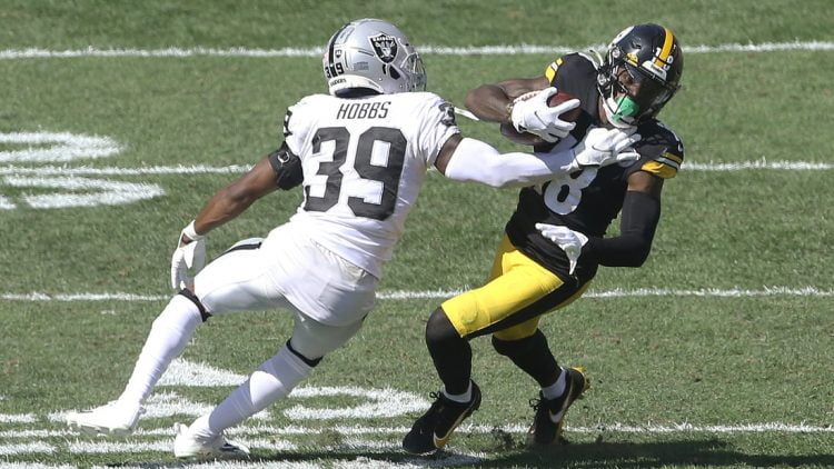 Sep 19, 2021; Pittsburgh, Pennsylvania, USA;  Las Vegas Raiders cornerback Nate Hobbs (39) defends Pittsburgh Steelers wide receiver Diontae Johnson (18) after a catch during the third quarter at Heinz Field. Las Vegas won 26-17. Mandatory Credit: Charles LeClaire-USA TODAY Sports