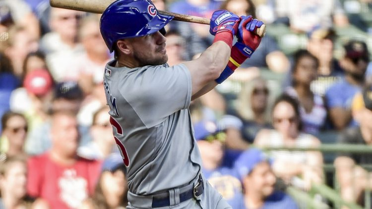 Sep 19, 2021; Milwaukee, Wisconsin, USA; Chicago Cubs third baseman Patrick Wisdom (16) hits a 3-run homer in the eighth inning against the Milwaukee Brewers  at American Family Field. Mandatory Credit: Benny Sieu-USA TODAY Sports