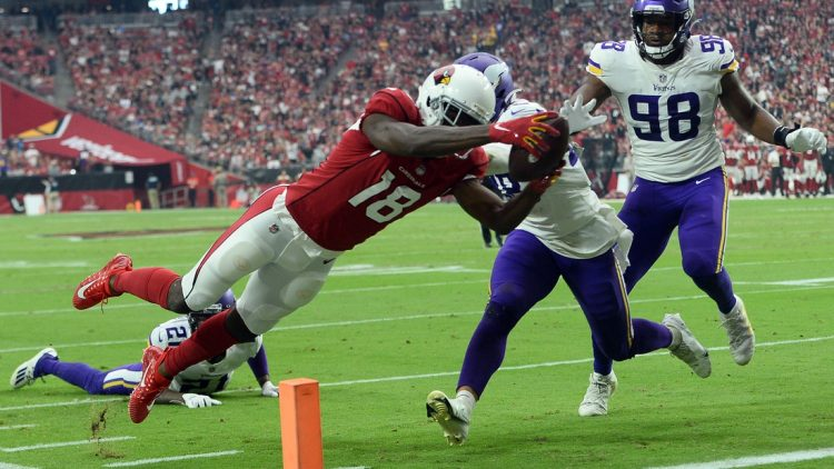 Sep 19, 2021; Glendale, Arizona, USA; Arizona Cardinals wide receiver A.J. Green (18) dives for a touchdown against the Minnesota Vikings during the second half at State Farm Stadium. Mandatory Credit: Joe Camporeale-USA TODAY Sports