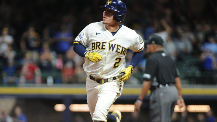 Sep 20, 2021; Milwaukee, Wisconsin, USA;  Milwaukee Brewers third baseman Luis Urias (2) rounds the bases after hitting a home run against the St. Louis Cardinals in the second inning at American Family Field. Mandatory Credit: Michael McLoone-USA TODAY Sports