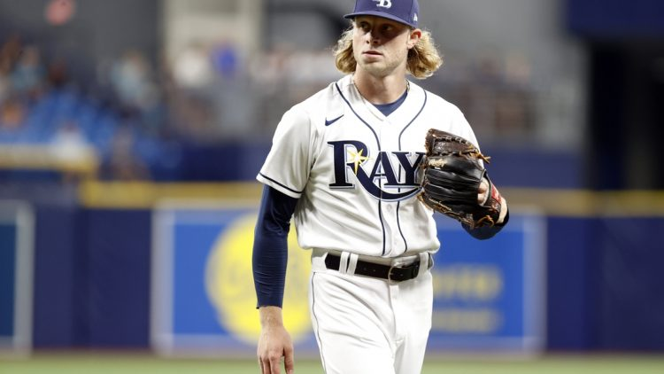 Sep 20, 2021; St. Petersburg, Florida, USA;   Tampa Bay Rays pitcher Shane Baz (11) looks on at the end of the second inning against the Toronto Blue Jays at Tropicana Field. Mandatory Credit: Kim Klement-USA TODAY Sports