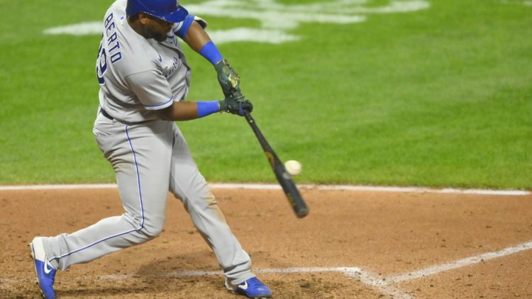 Sep 20, 2021; Cleveland, Ohio, USA; Kansas City Royals third baseman Hanser Alberto (49) doubles against the Cleveland Indians in the fourth inning at Progressive Field. Mandatory Credit: David Richard-USA TODAY Sports