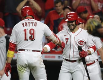 Sep 20, 2021; Cincinnati, Ohio, USA; Cincinnati Reds first baseman Joey Votto (19) reacts with third baseman Eugenio Suarez (7) after hitting a solo home run against the Pittsburgh Pirates during the fifth inning at Great American Ball Park. Mandatory Credit: David Kohl-USA TODAY Sports