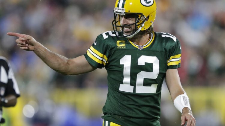 Sep 20, 2021; Green Bay, WIsconsin, USA; Green Bay Packers quarterback Aaron Rodgers (12) celebrates after a pass completion to wide receiver Davante Adams (not pictured) against the Detroit Lions at Lambeau Field. Mandatory Credit: Dan Powers/Appleton Post-Crescent via USA TODAY NETWORK