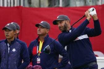 Sep 21, 2021; Kohler, Wisconsin, USA; Dustin Johnson watches his tee shot on the 1st hole during practice rounds for the 43rd Ryder Cup golf competition at Whistling Straits. Mandatory Credit: Michael Madrid-USA TODAY Sports