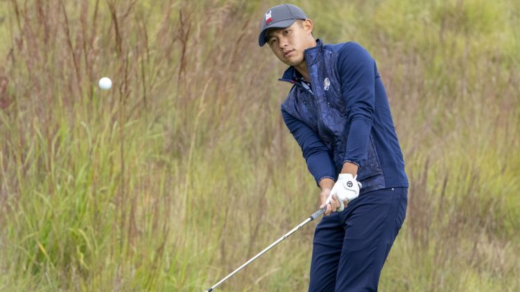 September 21, 2021; Kohler, Wisconsin, USA; U.S. Team player Collin Morikawa hits a chip shot on the practice area during a practice round for the 43rd Ryder Cup golf competition at Whistling Straits. Mandatory Credit: Kyle Terada-USA TODAY Sports