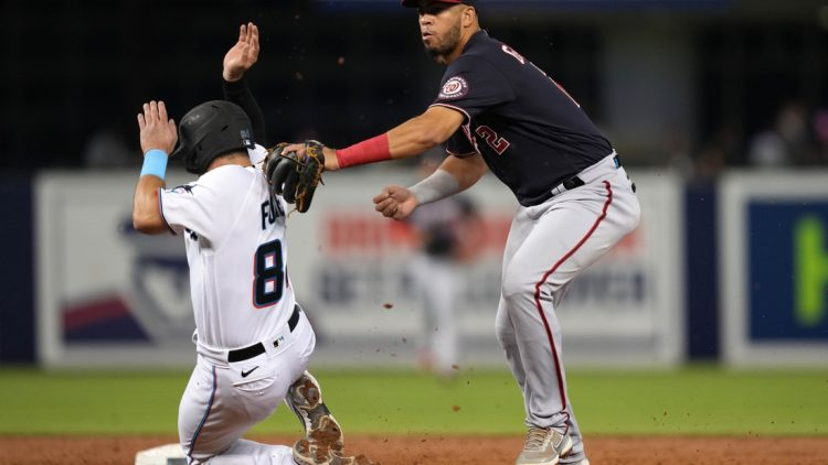 Sep 21, 2021; Miami, Florida, USA; Washington Nationals second baseman Luis Garcia (2) tags out Miami Marlins catcher Nick Fortes (84) while turning a double play in the 2nd inning at loanDepot park. Mandatory Credit: Jasen Vinlove-USA TODAY Sports