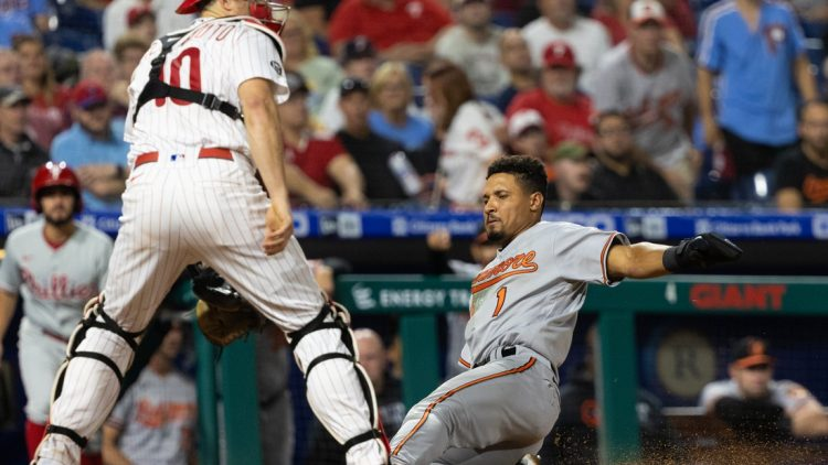 Sep 21, 2021; Philadelphia, Pennsylvania, USA; Baltimore Orioles shortstop Richie Martin (1) slides home safely past Philadelphia Phillies catcher J.T. Realmuto (10) during the fourth inning at Citizens Bank Park. Mandatory Credit: Bill Streicher-USA TODAY Sports