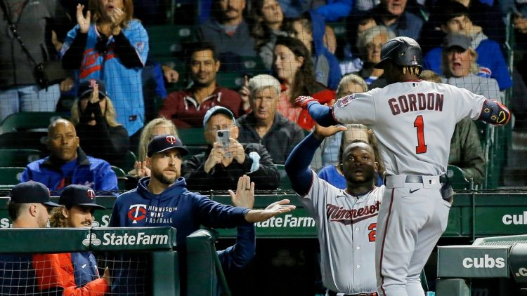 Sep 21, 2021; Chicago, Illinois, USA; Minnesota Twins left fielder Nick Gordon (1) is congratulated as he enters the dugout after hitting a two run home run against the Chicago Cubs during the fourth inning during the fourth inning at Wrigley Field. Mandatory Credit: Jon Durr-USA TODAY Sports