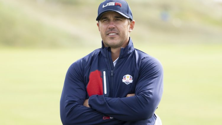 September 22, 2021; Haven, Wisconsin, USA; Team USA player Brooks Koepka poses for a photo during a practice round for the 43rd Ryder Cup golf competition at Whistling Straits. Mandatory Credit: Kyle Terada-USA TODAY Sports