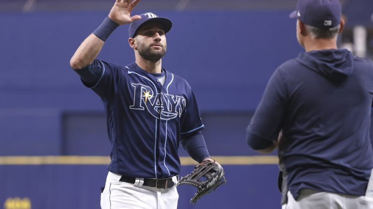 Sep 22, 2021; St. Petersburg, Florida, USA; Tampa Bay Rays center fielder Kevin Kiermaier (39) and manager Kevin Cash (16)  celebrate as they beat the Toronto Blue Jays to clinch a playoff spot at Tropicana Field. Mandatory Credit: Kim Klement-USA TODAY Sports