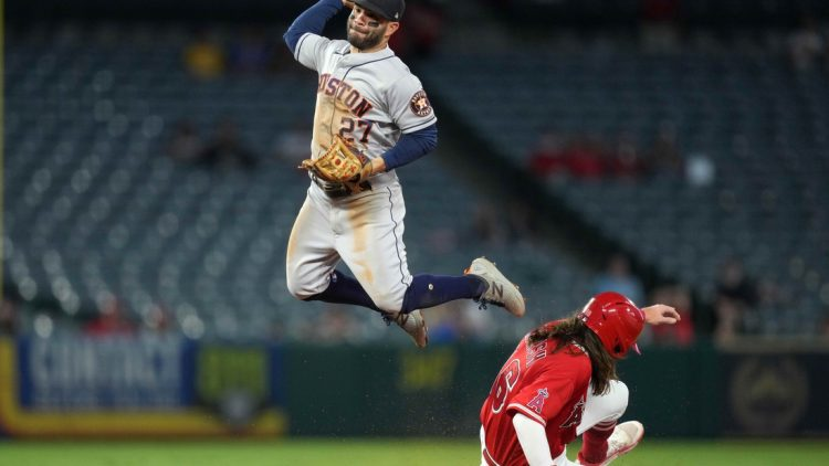 Sep 22, 2021; Anaheim, California, USA; Houston Astros second baseman Jose Altuve (27) forces out Los Angeles Angels center fielder Brandon Marsh (16) at second base in the second inning at Angel Stadium. Mandatory Credit: Kirby Lee-USA TODAY Sports