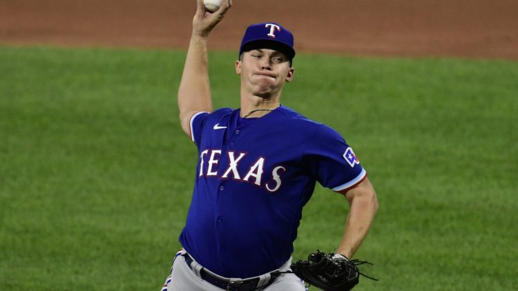 Sep 23, 2021; Baltimore, Maryland, USA; Texas Rangers starting pitcher Glenn Otto (49) delivers a third inning pitch against the Baltimore Orioles  at Oriole Park at Camden Yards. Mandatory Credit: Tommy Gilligan-USA TODAY Sports