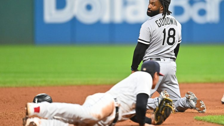 Sep 23, 2021; Cleveland, Ohio, USA; Chicago White Sox left fielder Brian Goodwin (18) looks back at Cleveland Indians second baseman Yu Chang (2) after Chang tagged Goodwin out during a rundown in the fourth inning at Progressive Field. Mandatory Credit: Ken Blaze-USA TODAY Sports