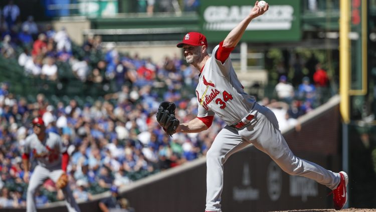 Sep 24, 2021; Chicago, Illinois, USA; St. Louis Cardinals starting pitcher J.A. Happ (34) delivers against the Chicago Cubs during the second inning of a Game 1 of the doubleheader at Wrigley Field. Mandatory Credit: Kamil Krzaczynski-USA TODAY Sports