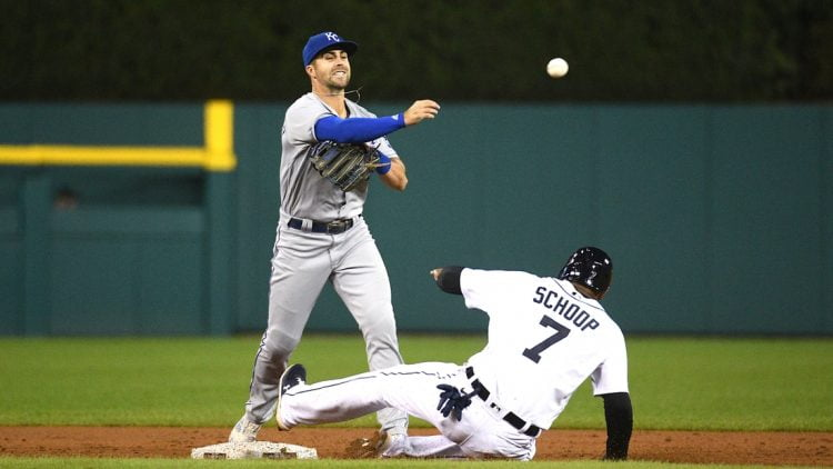 Sep 24, 2021; Detroit, Michigan, USA; Kansas City Royals second baseman Whit Merrifield (15) forces Detroit Tigers first baseman Jonathan Schoop (7) out at second base and throws for a double play during the third inning at Comerica Park. Mandatory Credit: Tim Fuller-USA TODAY Sports