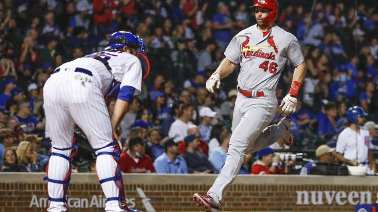 Sep 24, 2021; Chicago, Illinois, USA; St. Louis Cardinals first baseman Paul Goldschmidt (46) scores against the Chicago Cubs during the first inning of game 2 of a doubleheader at Wrigley Field. Mandatory Credit: Kamil Krzaczynski-USA TODAY Sports
