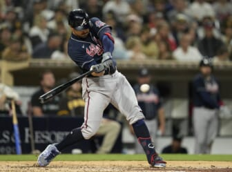 Sep 24, 2021; San Diego, California, USA;  Atlanta Braves left fielder Adam Duvall (14) hits an hits an RBI single against the San Diego Padres during the sixth inning at Petco Park. Mandatory Credit: Ray Acevedo-USA TODAY Sports