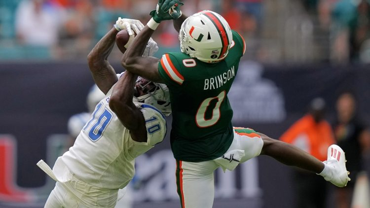 Sep 25, 2021; Miami Gardens, Florida, USA; Central Connecticut State Blue Devils cornerback Dexter Lawson Jr. (10) breaks up a pass intended for Miami Hurricanes wide receiver Romello Brinson (0) during the first half at Hard Rock Stadium. Mandatory Credit: Jasen Vinlove-USA TODAY Sports