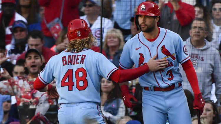Sep 25, 2021; Chicago, Illinois, USA; St. Louis Cardinals center fielder Harrison Bader (48) celebrates with St. Louis Cardinals left fielder Dylan Carlson (3) after scoring during the seventh inning against the Chicago Cubs at Wrigley Field. Mandatory Credit: Matt Marton-USA TODAY Sports