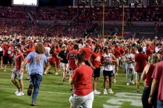 Sep 25, 2021; Raleigh, North Carolina, USA; North Carolina State Wolfpack fans storm the field after a win against the Clemson Tigers at Carter-Finley Stadium. Mandatory Credit: Rob Kinnan-USA TODAY Sports