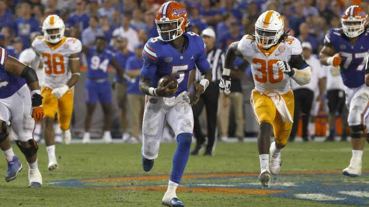 Sep 25, 2021; Gainesville, Florida, USA; Florida Gators quarterback Emory Jones (5) runs with the ball against the Tennessee Volunteers during the third quarter at Ben Hill Griffin Stadium. Mandatory Credit: Kim Klement-USA TODAY Sports