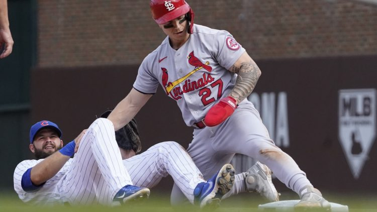 Sep 26, 2021; Chicago, Illinois, USA; St. Louis Cardinals left fielder Tyler O'Neill (27) steals second base as Chicago Cubs second baseman David Bote (13) makes a late tag during the sixth inning at Wrigley Field. Mandatory Credit: David Banks-USA TODAY Sports