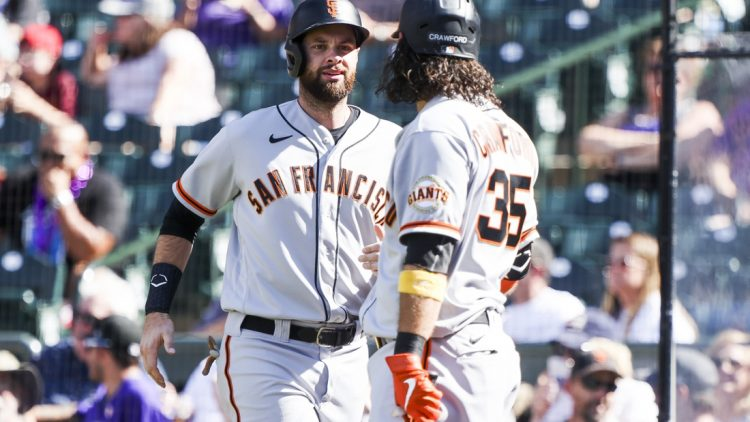Sep 26, 2021; Denver, Colorado, USA; San Francisco Giants first baseman Brandon Belt (9) celebrates with shortstop Brandon Crawford (35) after scoring against the Colorado Rockies off a hit by left fielder Kris Bryant (23) in the fifth inning at Coors Field. Mandatory Credit: Michael Ciaglo-USA TODAY Sports