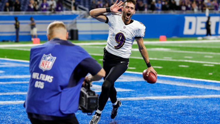 Baltimore Ravens kicker Justin Tucker celebrates as he exits the field, after his record 66-yard field goal lifted the Ravens past the Detroit Lions, 19-17, at Ford Field in Detroit on Sunday, Sept. 26, 2021.