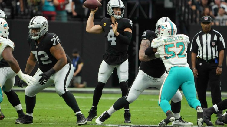 Sep 26, 2021; Paradise, Nevada, USA; Las Vegas Raiders quarterback Derek Carr (4) throws the ball in the first quarter against the Miami Dolphins at Allegiant Stadium. Mandatory Credit: Kirby Lee-USA TODAY Sports