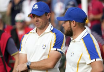 Sep 26, 2021; Haven, Wisconsin, USA; Team Europe player Rory McIlroy and Team Europe player Tyrrell Hatton look on from the 15th green during day three singles rounds for the 43rd Ryder Cup golf competition at Whistling Straits. Mandatory Credit: Michael Madrid-USA TODAY Sports