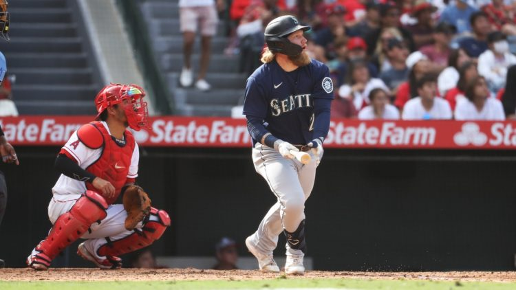 Sep 26, 2021; Anaheim, California, USA; Seattle Mariners left fielder Jake Fraley (28) hits a double against the Los Angeles Angels in the eighth inning at Angel Stadium. Mandatory Credit: Kiyoshi Mio-USA TODAY Sports
