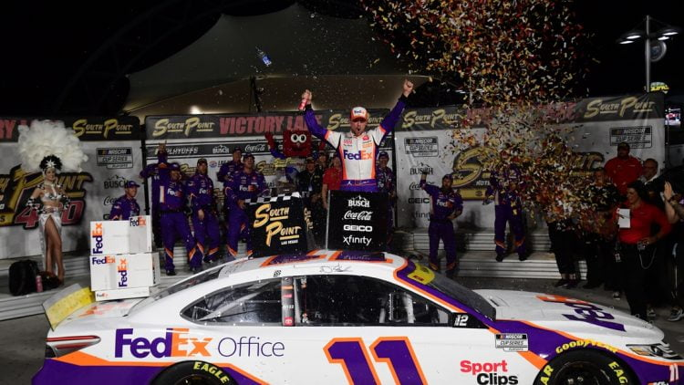 Sep 26, 2021; Las Vegas, Nevada, USA; NASCAR Cup Series driver Denny Hamlin (11) celebrates his victory of  the South Point 400 at Las Vegas Motor Speedway. Mandatory Credit: Gary A. Vasquez-USA TODAY Sports