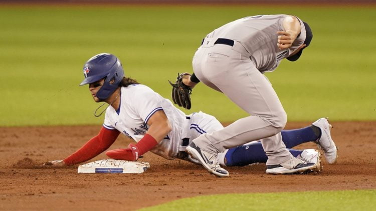 Sep 28, 2021; Toronto, Ontario, CAN; Toronto Blue Jays shortstop Bo Bichette (11) steals second base against New York Yankees second baseman Gleyber Torres (25) during the first inning at Rogers Centre. Mandatory Credit: John E. Sokolowski-USA TODAY Sports