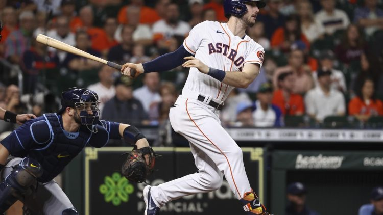 Sep 30, 2021; Houston, Texas, USA; Houston Astros right fielder Kyle Tucker (30) hits a double during the second inning against the Tampa Bay Rays at Minute Maid Park. Mandatory Credit: Troy Taormina-USA TODAY Sports