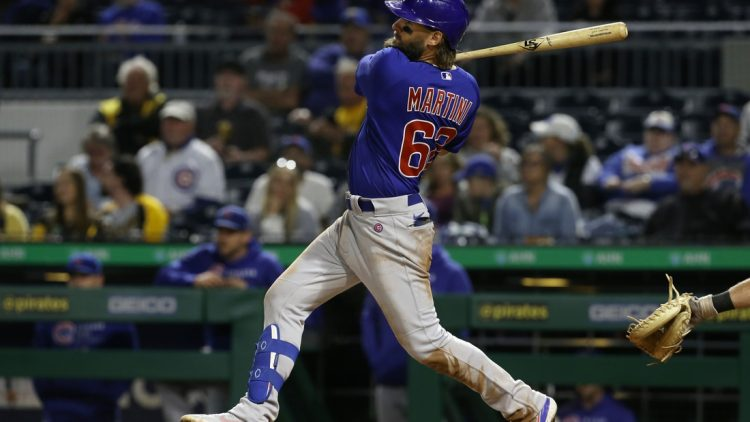 Sep 30, 2021; Pittsburgh, Pennsylvania, USA; Chicago Cubs right fielder Nick Martini (62) singles against the Pittsburgh Pirates during the fifth inning at PNC Park. Mandatory Credit: Charles LeClaire-USA TODAY Sports