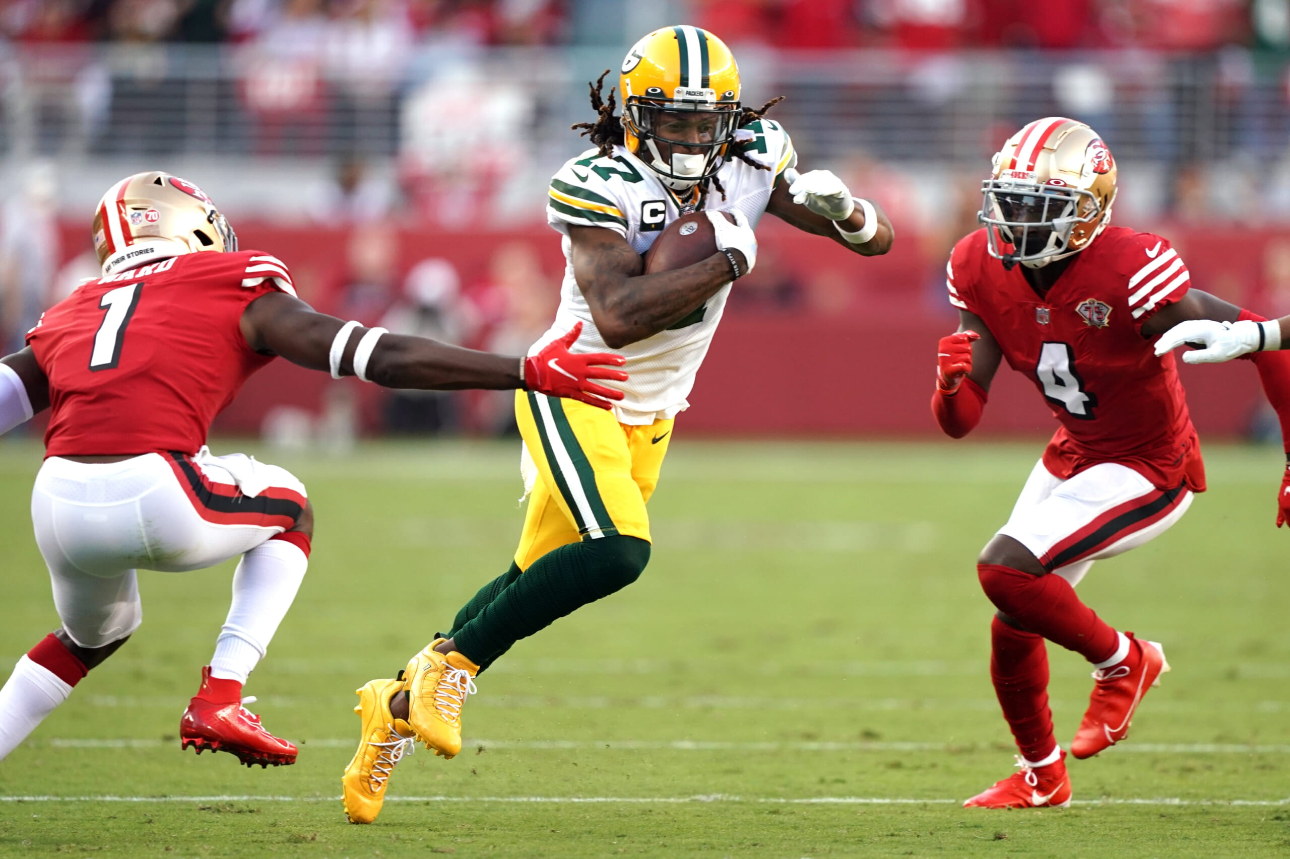 Green Bay Packers' Davante Adams knocked out, officials blasted for non-call